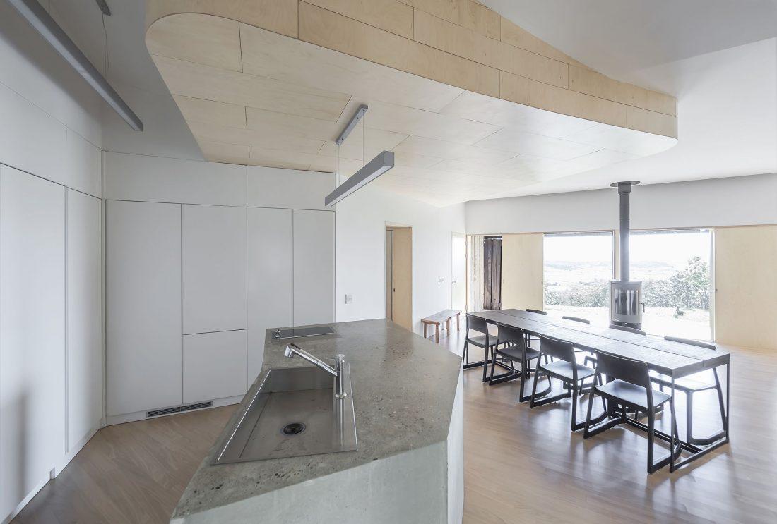 Дом на склоне горы от студии BCHO Architects 16