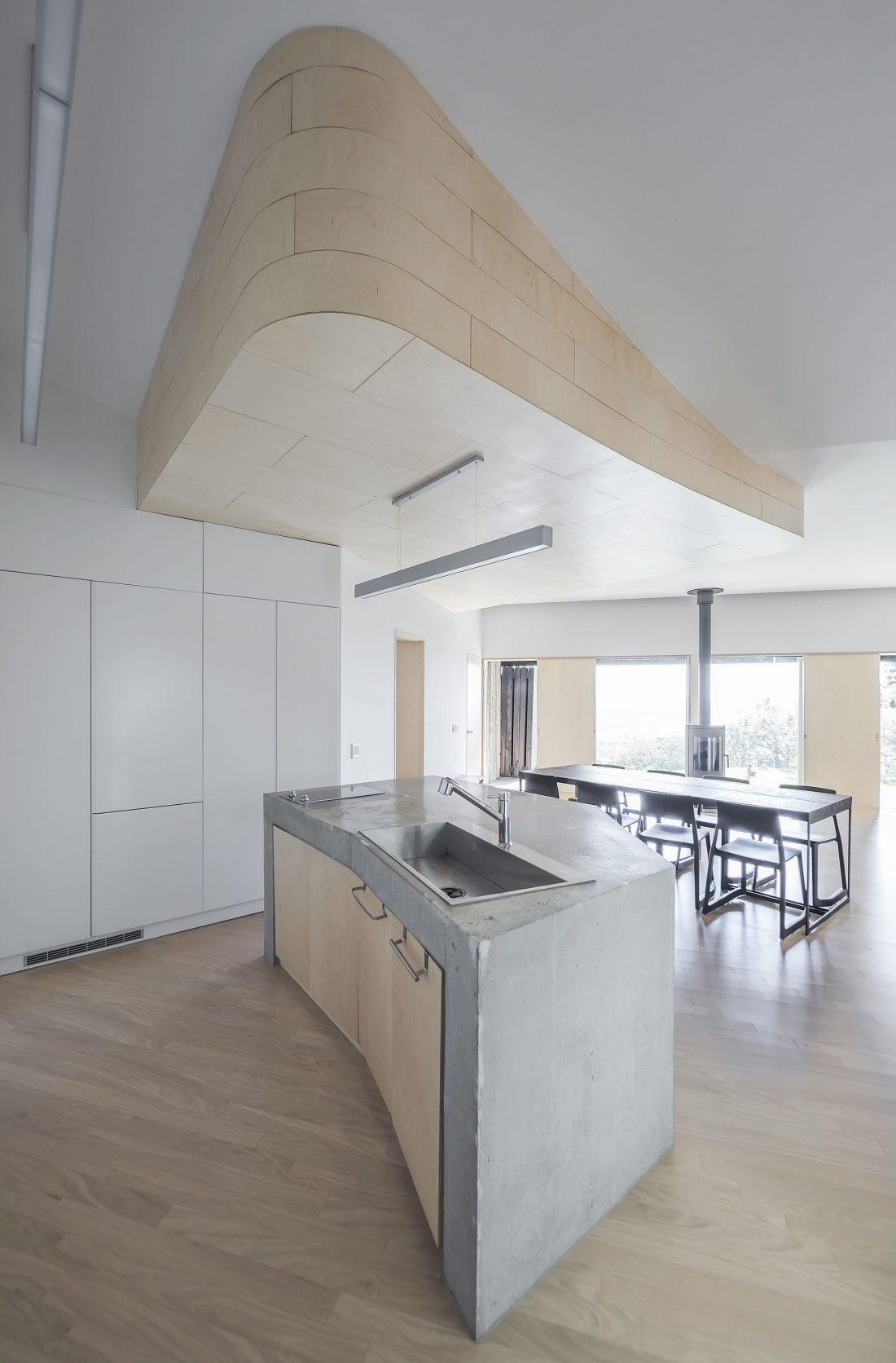Дом на склоне горы от студии BCHO Architects 23
