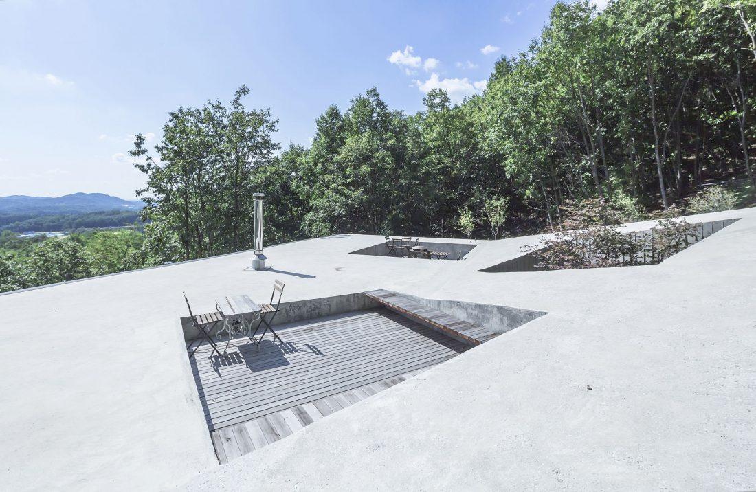 Дом на склоне горы от студии BCHO Architects 7